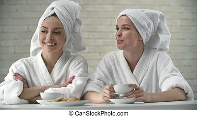 Relaxation Room - Close up of girls in bathrobe with head...