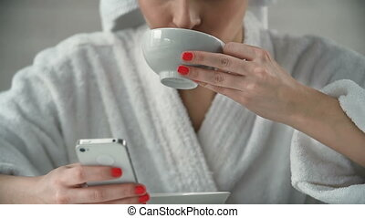 Morning Coffee - Cropped woman with head wrapped in towel...