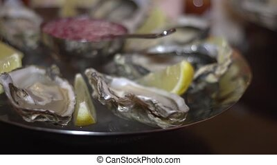 Oysters with lemon on a plate