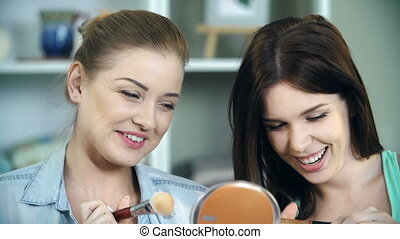 Feminine Wiles - Close up of two friends doing makeup