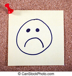 Unhappy Face on a Piece of Memo Paper - An unhappy face on a...