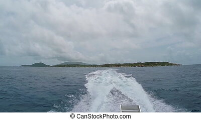 Boat Wake with Virgin Gorda - A view of the wake created by...