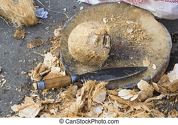 coconut on wood block with knife