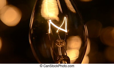 Christmas Light Filament Close Up - A Christmas lightbulb...
