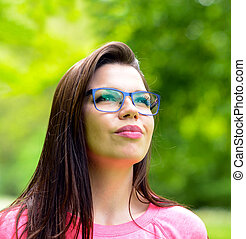 Portrait charming young woman glasses smiling background...
