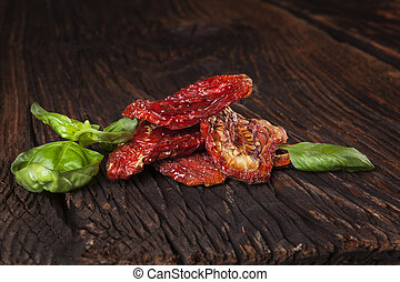 Sundried tomatoes - Delicious dried tomatoes on brown wooden...