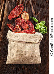 Sundried tomatoes. - Delicious dried tomatoes on brown...