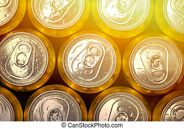 Abstract vie of cold cans with refreshing drink background