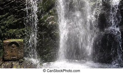 waterfall - Holy waterfall with jizo statues