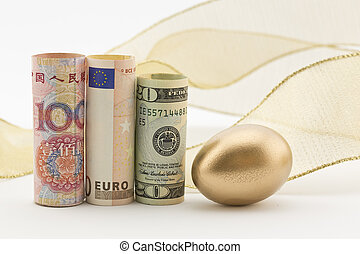 Three major currencies with gold egg and flourish of ribbon...
