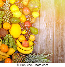 Huge group of fresh colorful fruit on wooden background - Healthy food