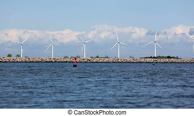 Wind turbines at sea of the coast of Copenhagen, Denmark...