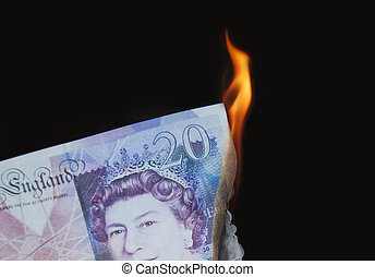 Money to burn - 20 pound note burning, concept, wealthy,...