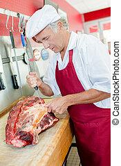 Butcher preparing a cut of meat