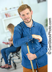 Boyfriend doing housework for his disabled girlfriend