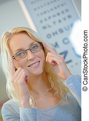 Woman at the opticians