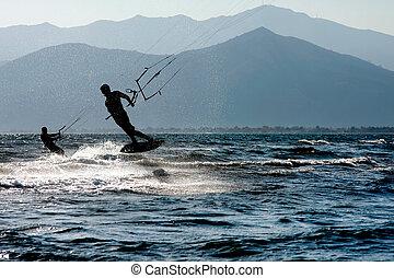 Kite surfing - Kite surfers at Skinias beach in Greece.