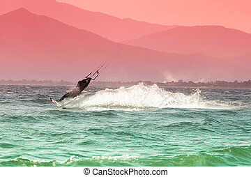 Kite surfing - Kite surfers at Skinias beach in Greece