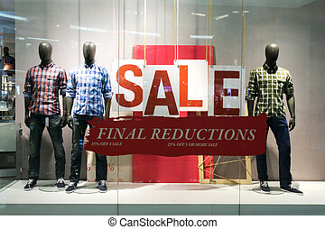 clothes storefront window with sale poster