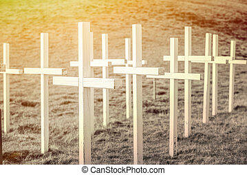 Wooden cross on field