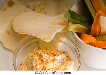 hummus dip with pita brad and vegetable - middle eastern...