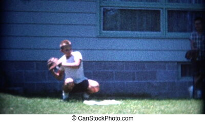 (8mm Vintage) Boy Catching Baseball - A retro 8mm...