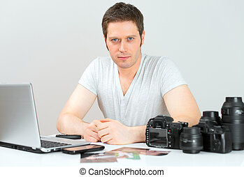 Male photographer working at his workplace