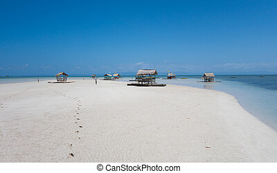 Floating hut on tropical beach