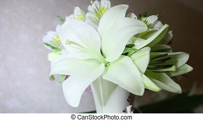 view of white wedding lily flowers in vase
