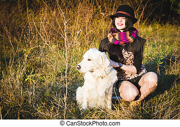 Girl with dog in park