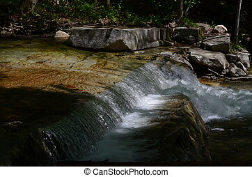 Natural waterfall - A natural waterfall over smooth stones