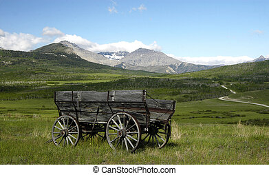 A SETTLERS WAGON THE PRAIRIES - A SETTLERS WAGON THE...