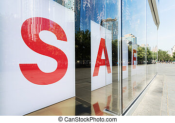 sale poster in shop  exhibition window