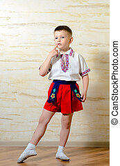 Little boy in ballet shoes and costume