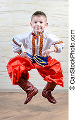 Ukrainian child performing a traditional dance - Ukrainian...