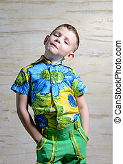 Boy Wearing Floral Print Shirt with Hands on Hips - Young...