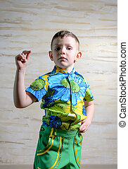 Young Boy Dancing and Snapping Fingers - Young Boy Wearing...