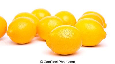 lemons - full ripe lemons on a white background