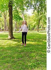 Jumping girl in summer