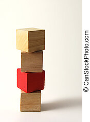 Toy blocks - Four wooden toy blocks one in red