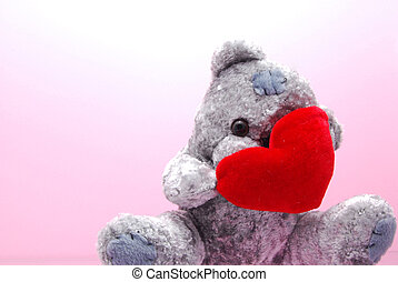 Shy teddy - A shy teddy bear hiding behind a bright red...