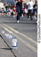 Bottle of water at a marathon - Focus on a bottle of water...