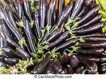 Eggplants - Pile of fresh eggplants sold at a public market