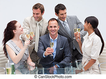 Business team toasting with champagne in the office - Happy...