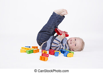 Boy playing with cubes - Blond young boy is playing with...
