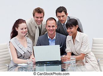 Business team working together in an office - Smiling...