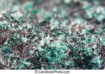 Chrysocolla is a hydrated copper cyclosilicate (?u,...