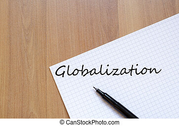 Globalization concept - White blank notepad on office wooden...