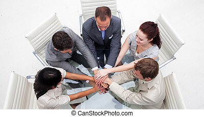 High angle of business people with hands together. Concept...