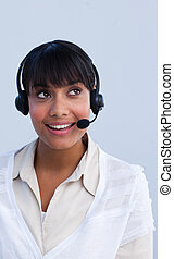 Beautiful ethnic businesswoman working in a call center